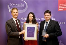 Richard Wilson presents the award to Sophia and Shane
