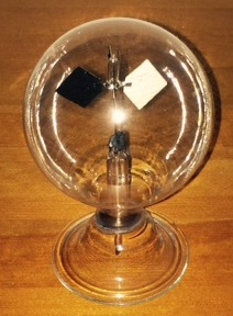 This almost antique Crookes radiometer shows how the photons from the sun can move objects!