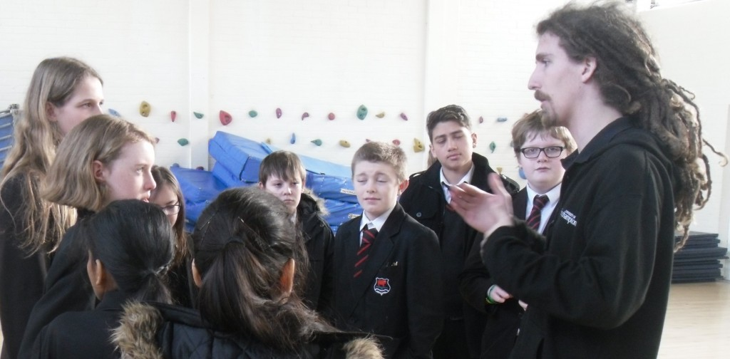 Sam talking to students
