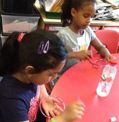 Children at Grangetown Primary making dreamcatchers!