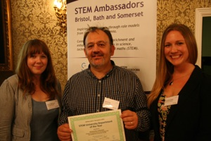 Me receiving the STEM Network Award for my outreach efforts