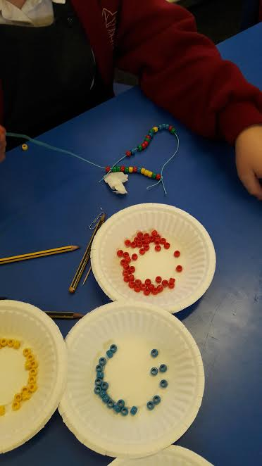 The children get to create their own bead DNA strands.